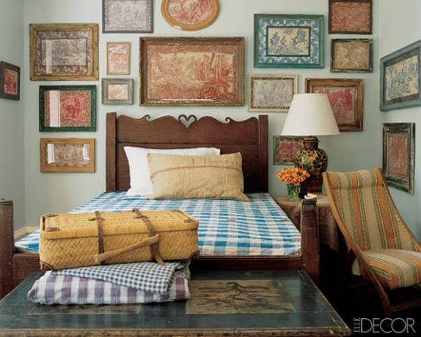 Ticking stripes in a bedroom mixed with checked fabric