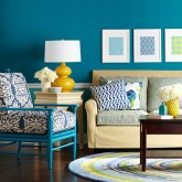 dazzling-living-room-with-blue-sky-color-wall-decoration-with-fabric-cushions-and-sofa