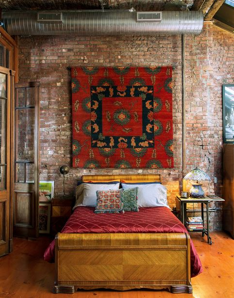 handmade rug hanging on wall  in actor b.d. wongs loft