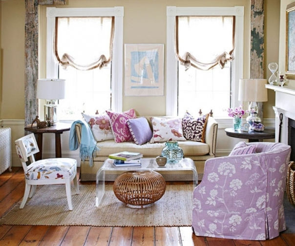 Lavender living room with lucite coffee table and floral armchair