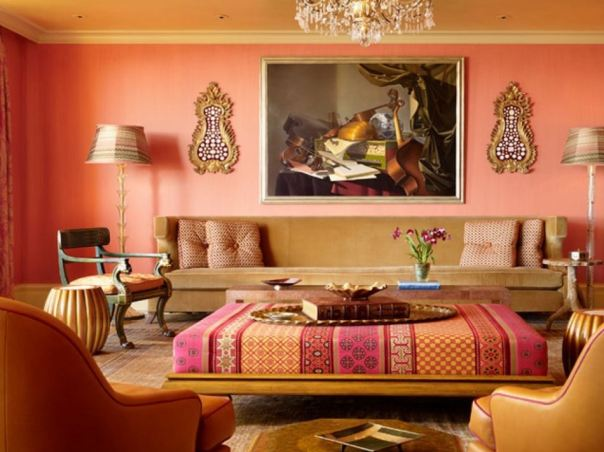Pink and orange living room with embroidered ottoman