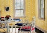 Yellow dining room with Schumacher Zanzibar Trellis wallpaper