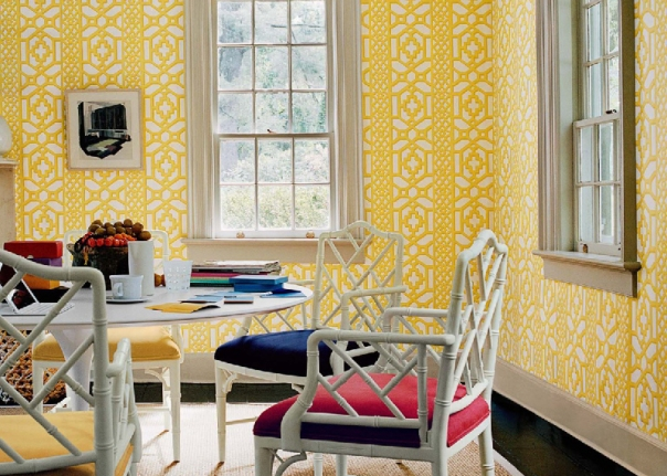Yellow dining room with Schumacher Zanzibar Trellis wallpaper