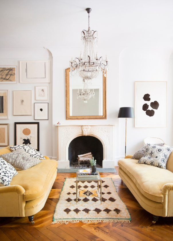 Ali Cayne West Village townhouse with yellow velvet sofas via Domino