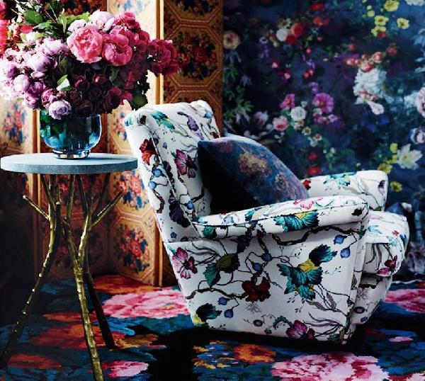 Dark floral chair and dark floral wallpaper via Vogue Living