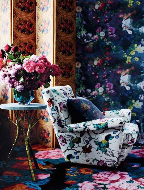 Floral chair with dark floral wallpaper via Vogue Living Australia