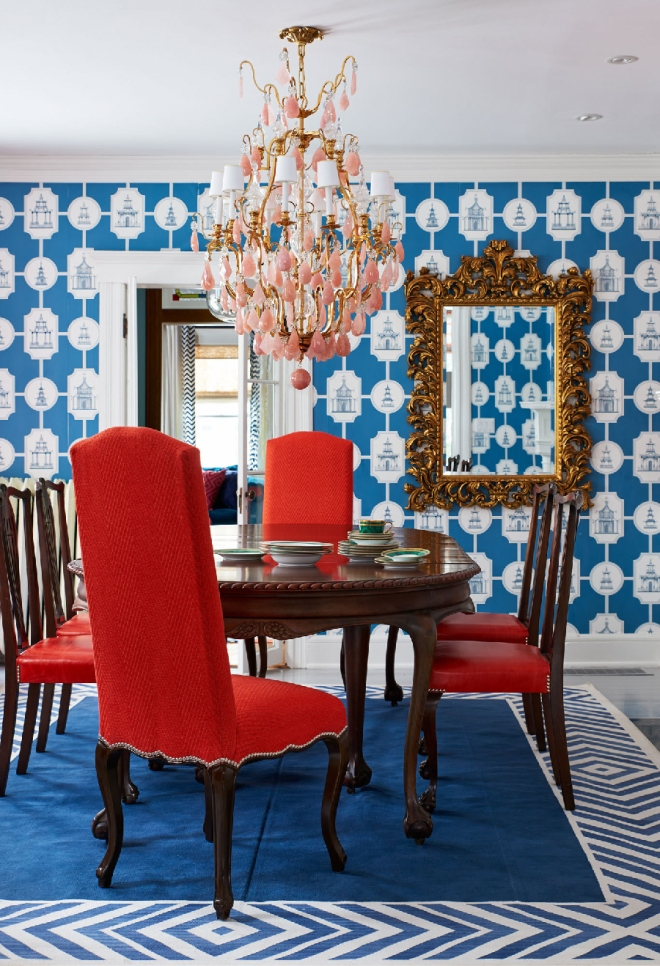 Red white and blue dining room with coral chandelier via Lonny