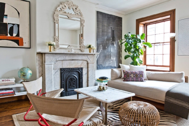 Chelsea townhouse living room with marble mantelpiece via The New York Times