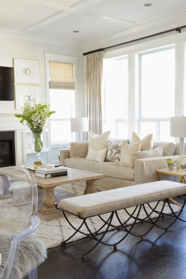 Slipcovered sofa and neutrals in living room via Style Me Pretty Living