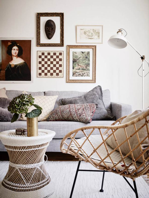 Modern Stockholm apartment with wicker furniture via The Style Files